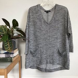 Button back semi-sheer sweater